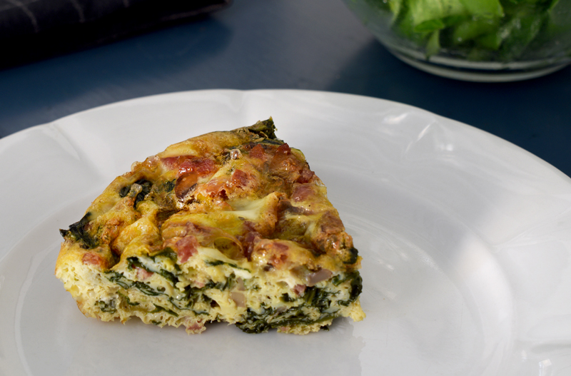 Slice of Crustless Spinach Quiche
